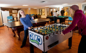 photo - 十大网赌官网 students play table soccer and pool in the residence hall game rooom.